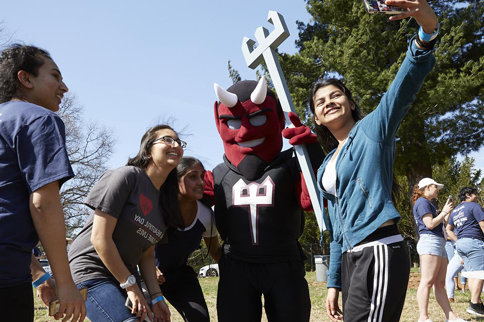 Students taking a selfie with Drake